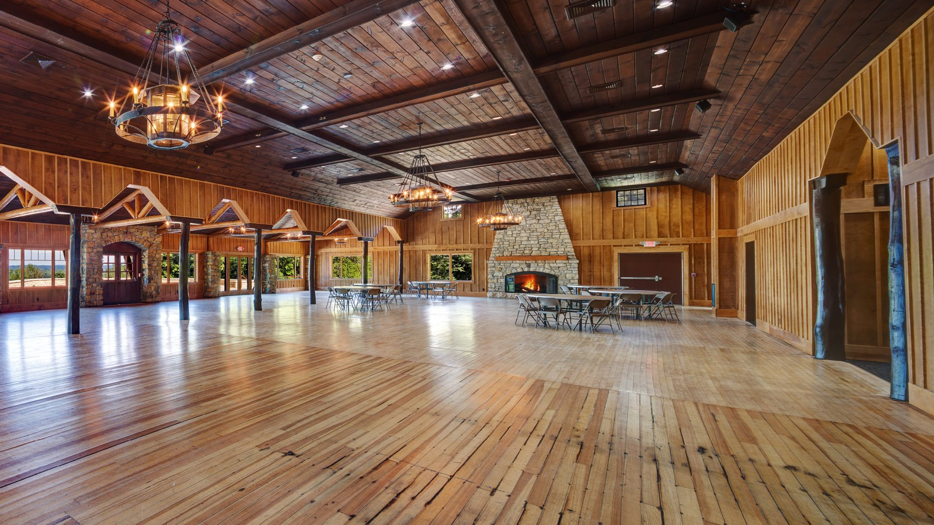wooden interior of Eagle Point Lodge with stone fire place