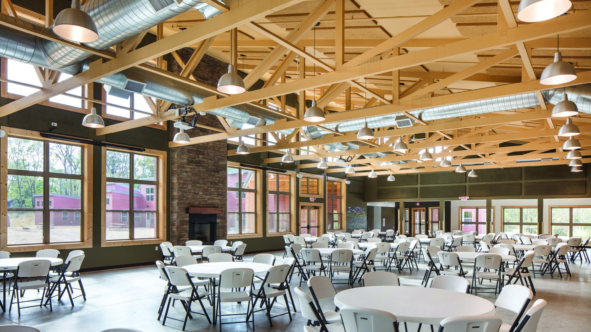 dining hall with round folding tables and chairs at the Girl Scouts of Eastern Iowa and Western Illinois Camp Liberty Lodge