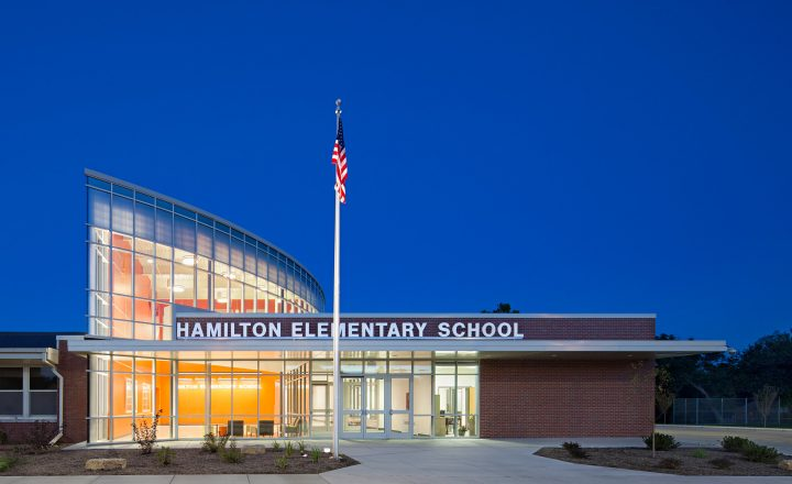 brick and glass exterior of Hamilton Elementary at night