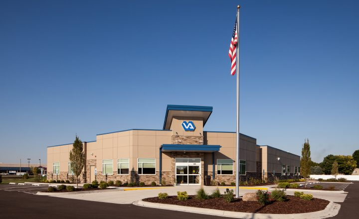 exterior of the Verterans Affairs Community Outpatient Clinic with a flag outside