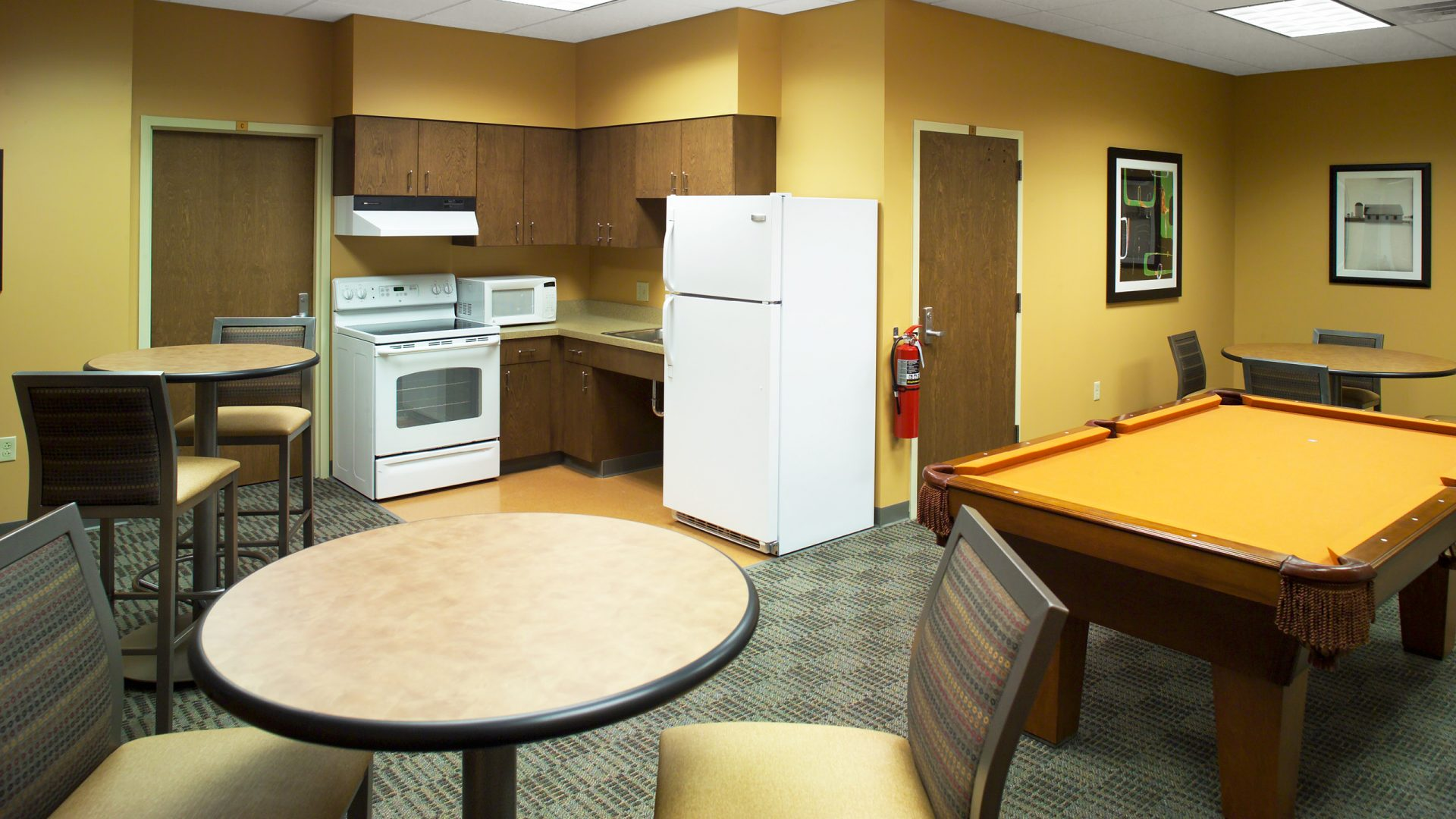 yellow apartment living area at Monmouth College's Gracie Peterson Hall