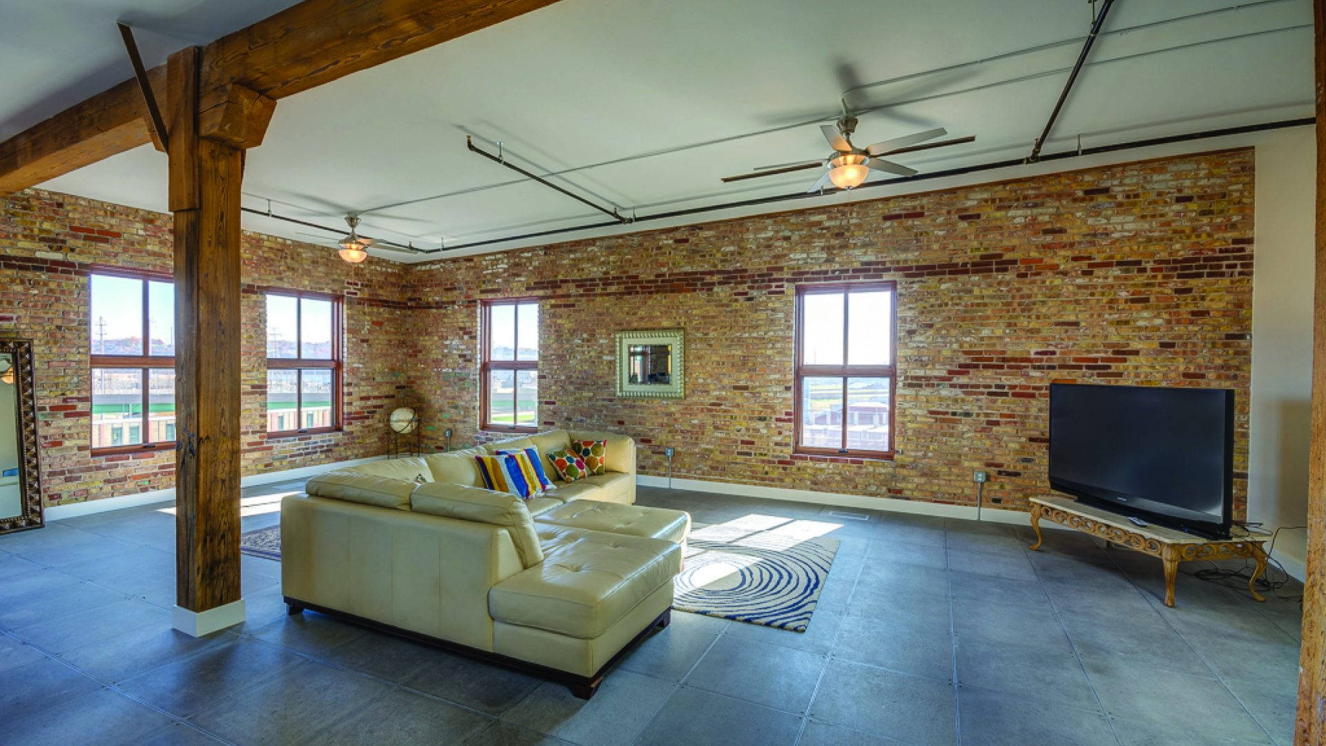 living area at Novelty Iron Works with two brick exterior walls