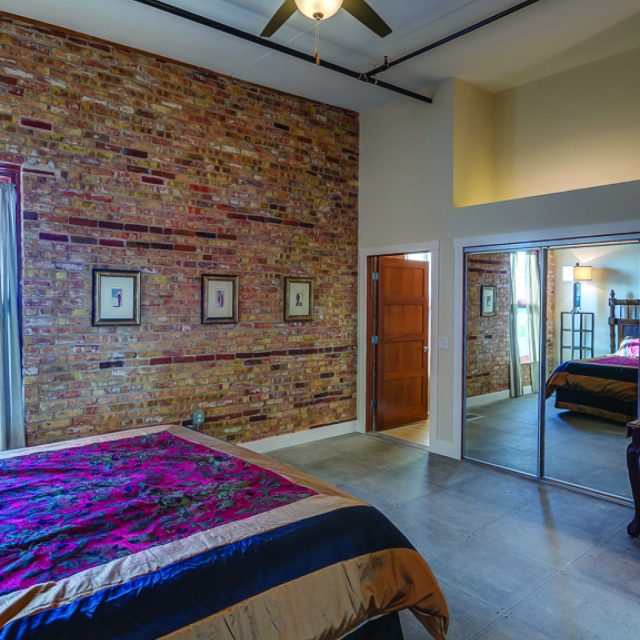 guest room with one brick wall at Novelty Iron Works
