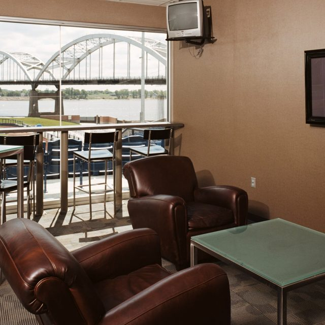 suite with recliners and a television at Modern Woodmen Park